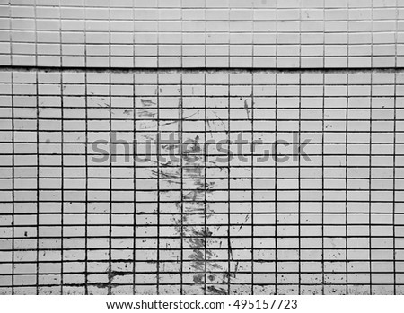 Grunge texture of white tiles on old wall background