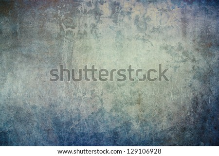 Grunge, textured concrete wall with subtle blue, grey, green and brown hues. - stock photo