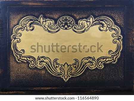 grunge textured surface brass face plate or label with antique wood background - stock photo