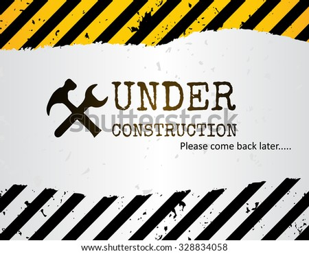 Grunge under construction background with crossed hammer and wrench.
