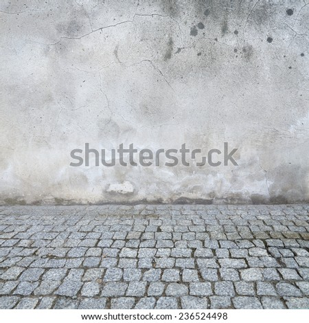 grunge urban background, old wall texture bright plaster and blocks road sidewalk abandoned exterior urban background for your concept or project - stock photo