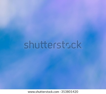 Grunge, vintage background, looks like an expressive application of paint on the canvas. Texture similar to lightning sky. Heterogeneous grunge texture with blur and graininess
