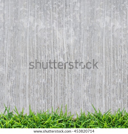 Grunge vintage background of concrete texture and green grass. - stock photo