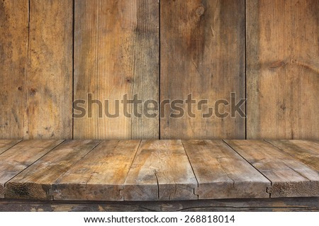 Grunge Vintage Wooden Board Table In Front Of Old Wooden Background. Ready  For Product Display