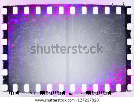 Grunge violet film strip frame - stock photo