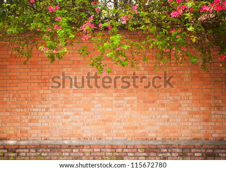 grunge wall background with flowers - stock photo