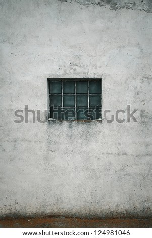 Grunge wall with a window