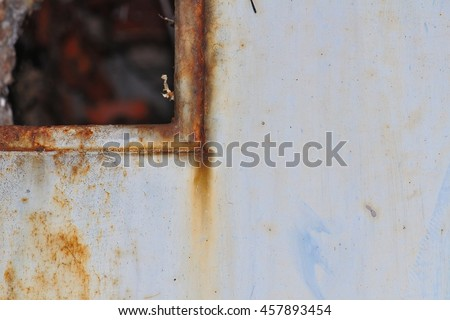 Grunge wall with metallic wicket detail - stock photo