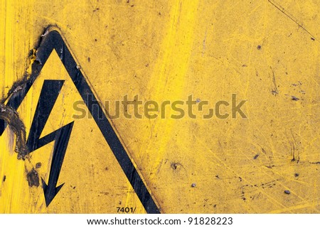 grunge warning sign on dirty yellow metal