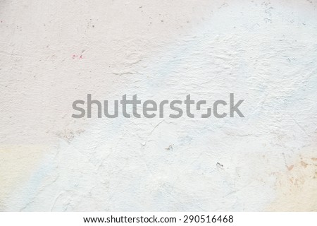 Grunge white background with cracks and grain. Brick wall with the whitewash falling off fragment as a background texture - stock photo