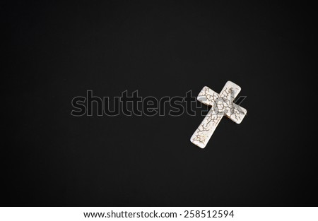 Grunge white bone rosary with black bible on dark wooden table the book Easter or Christian beliefs - stock photo