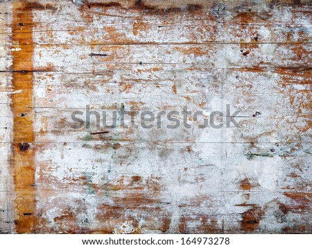 Grunge wood background texture with weathered white paint and cracks on a wooden panel - stock photo