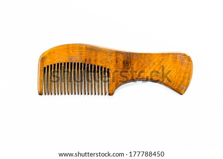 grunge wood comb on white background