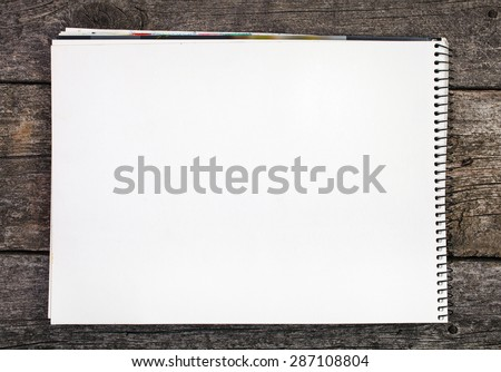 grunge wooden background with blank paper - stock photo