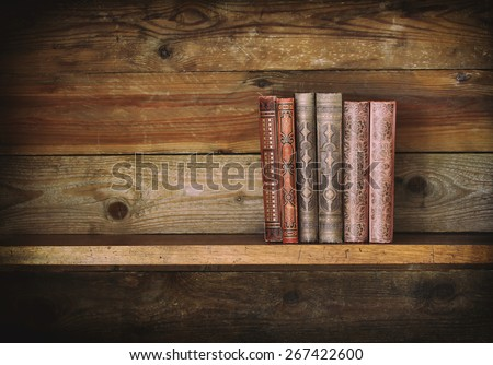 grunge wooden shelf with old books. - stock photo