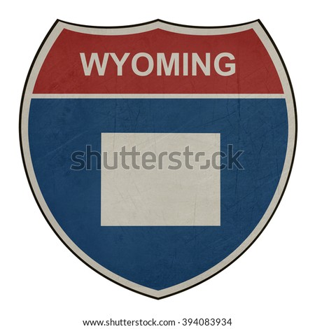 Grunge Wyoming American interstate highway road shield isolated on a white background. - stock photo
