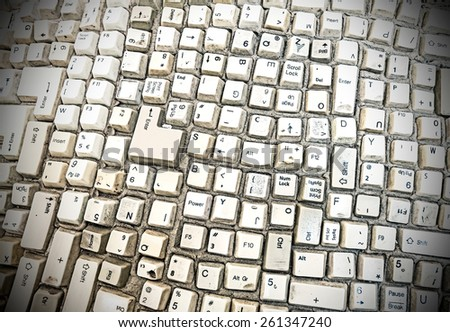 Grungy abstract background made of computer keyboard keys. - stock photo