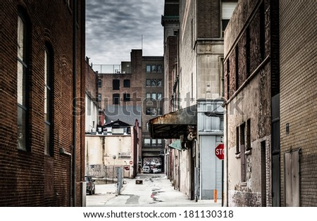 Grungy alley in downtown Baltimore, Maryland. - stock photo