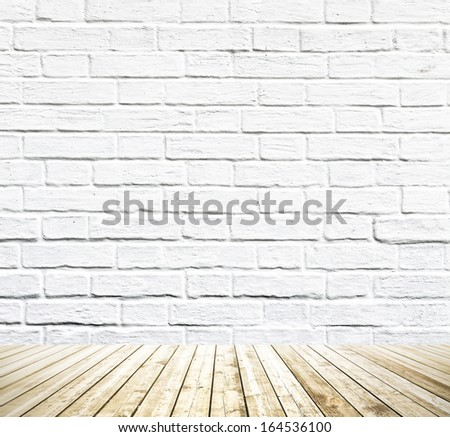 Grungy architecture textured white brick and light gray stone wall with warm brown wooden floor inside old neglected and deserted darken rural room interior, masonry and carpentry brickwork concept - stock photo