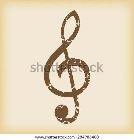 Grungy brown icon with image of treble clef, on beige background - stock photo