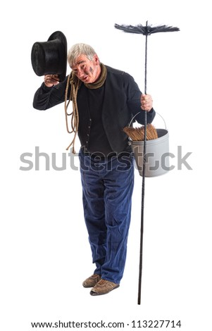 Grungy chimney sweep greeting with his top hat - stock photo