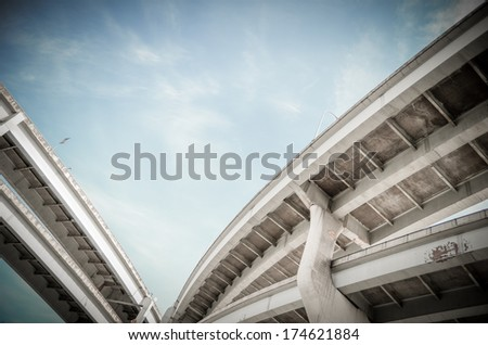 Grungy City Highway Overpass From Below With Copy Space - stock photo