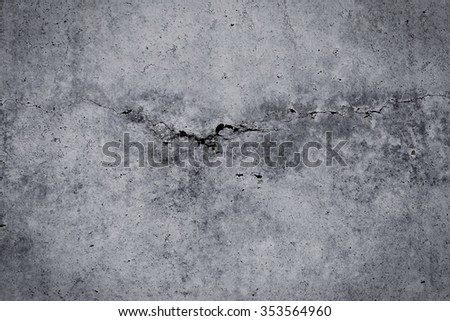 Grungy cracked concrete wall and floor as background texture - stock photo