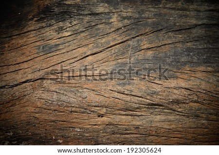 Grungy cracked wooden board by closeup textured background - stock photo