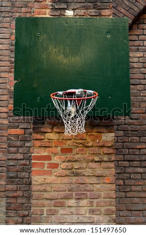 Grungy, Damaged Urban Basketball Net Against Brick Wall - stock photo
