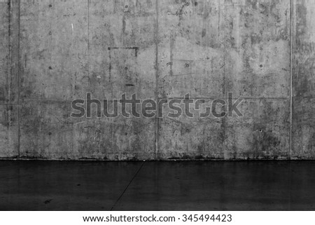 Grungy dark concrete wall and wet floor for background texture