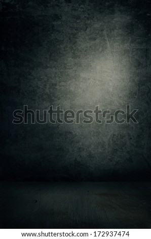 Grungy dark empty interior with spot light