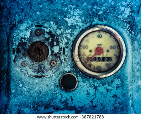 Grungy Dashboard Of A Vintage Blue Scooter Or Moped - stock photo