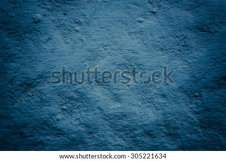 Grungy Deep blue concrete wall background vintage color tone style - stock photo