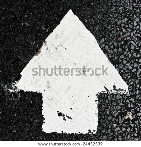 grungy, dirty view of asphalt with arrow