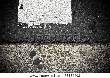grungy, dirty view of asphalt with distinct white stripe