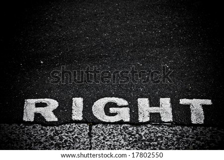 """grungy, dirty view of asphalt with the word """"RIGHT"""" - stock photo"""