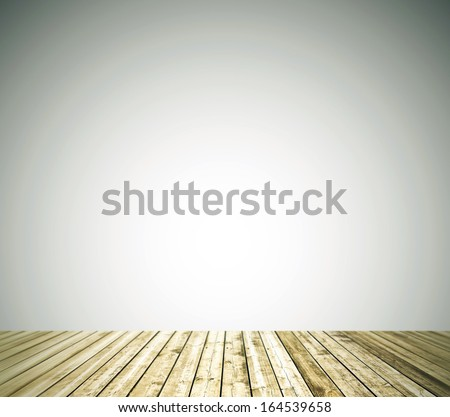 Grungy empty textured white brick and blank stone clean wall with warm brown wooden floor in rural darken room, old neglected and deserted interior, masonry and carpentry brickwork concept - stock photo