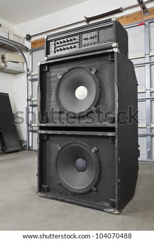 Grungy garage band vintage bass amplifier. - stock photo