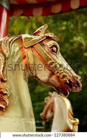Grungy Horses On An Ancient Merry-Go-Round Ride - stock photo