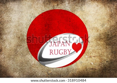 Grungy Japanese flag with a rugby ball and the words Japan loves rugby written on it  - stock photo