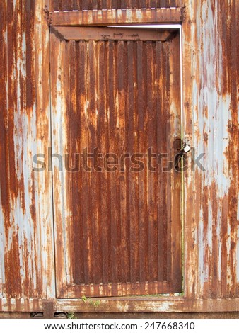 grungy metal surface and lock on rusty iron door - stock photo