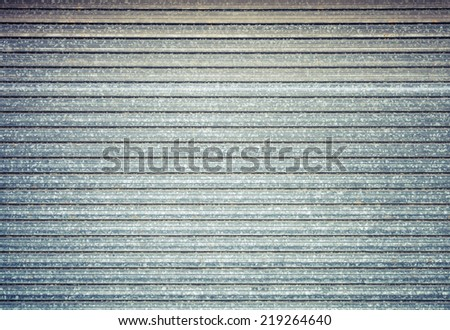 Grungy metal wall background texture with retro toned effect - stock photo