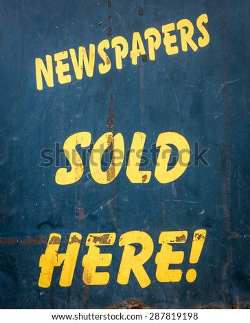 Grungy Old Newspapers Sold Here Sign Outside A Newsagents In The UK - stock photo