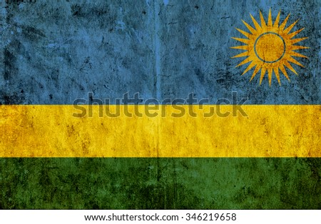 Grungy paper flag of Rwanda - stock photo