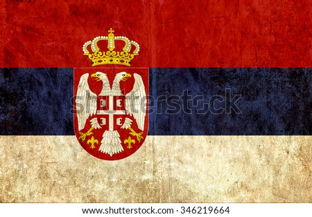 Grungy paper flag of Serbia - stock photo