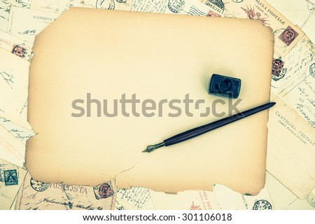 Grungy paper sheet, ink pen, old letters and postcards. Vintage texture background.  - stock photo