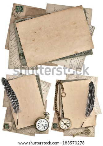 grungy papers and postcards isolated on white background. antique feather pen, clock and compass. journey concept - stock photo