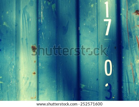 Grungy,  steel barrack wall texture background (with number 17 7 0) - classic style - stock photo