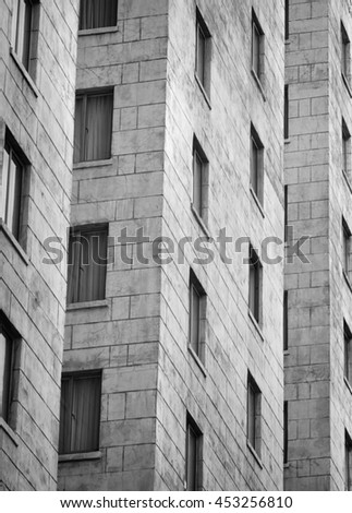 Grungy Stone Apartment Building Black and White - stock photo