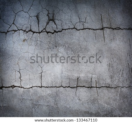 Grungy stone wall two horizontal cracks. - stock photo